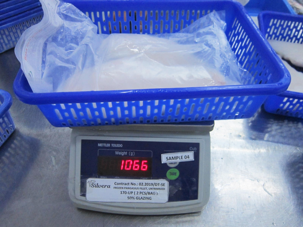 Checking Gross Weight Of The Products With Packaging